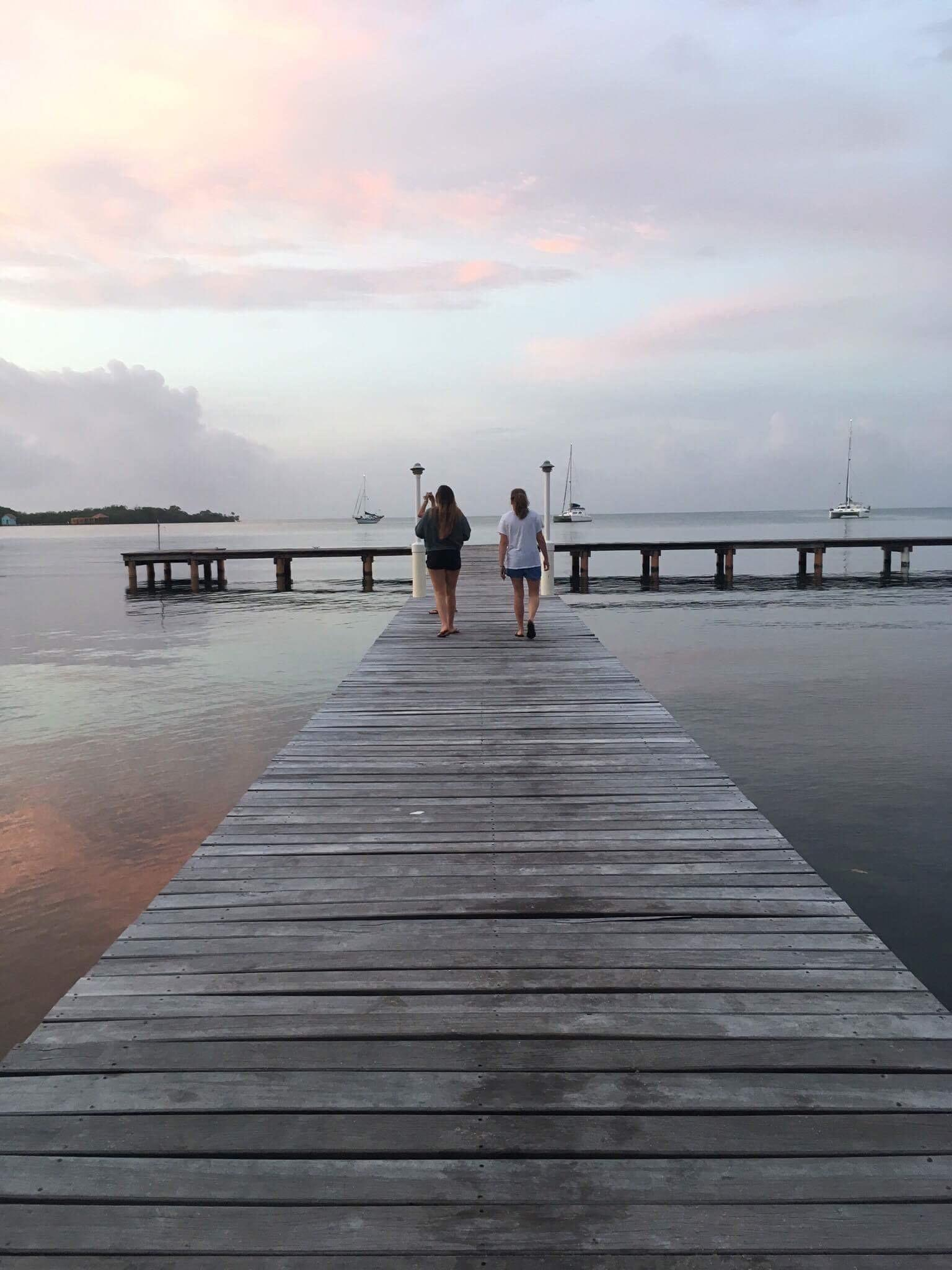 Projects Abroad marine conservation group volunteers walking down a dock